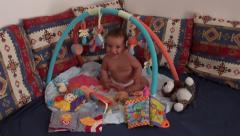 Happy baby at the playing area Stock Footage