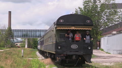 Historic steam locomotive and train rumbles through Waterloo Ontario Stock Footage