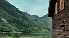 Europe Norway Geirangerfjord 049 natural log cabin in front of landscape Stock Footage