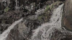 Water pouring on rocks - stock footage