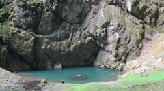 pan shot from huge abyss of cave system in Czech republic - stock footage
