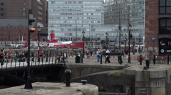Tourists at albert dock, liverpool city centre, england Stock Footage