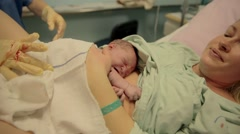 Nurse put number on a born baby and mom - stock footage