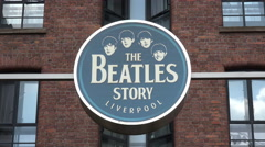 the beatles story tourism sign at the albert dock, liverpool, england - stock footage
