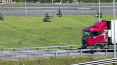 Semi-truck on turning to the highway driving on St. Petersburg ring road, Russia - stock footage