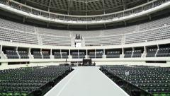 Runway between seats at empty coliseum before show. Stock Footage