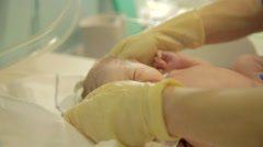 Nurse measure just-born baby child Stock Footage