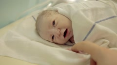 Just-born baby boy grab fathers finger - stock footage