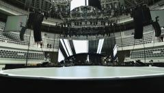Pedestal shot of lights and sound set-up at concert.  Black, white, gray tones - stock footage