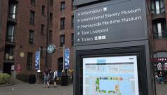 The beatles story tourism sign at the albert dock, liverpool, england Stock Footage