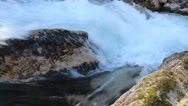 Stock Video Footage of meltwater from the mountains flows powerfully into the valley