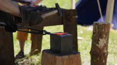Blacksmith working on metal on anvil Stock Footage