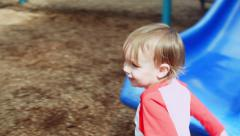 Cute Little Boy Gets Off Playground Slide All By Himself Stock Footage