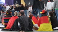 Small Group Supporters of German Football Team Sitting Waiting for Semifinals Footage