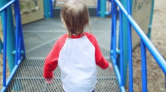 Little Boy Walks On Play Structure Platform Stock Footage
