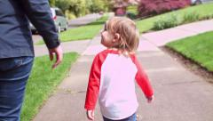 A Mom And Her Little Boy Go For A Walk In Their Neighborhood, Little Boy Points - stock footage