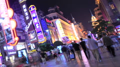 Nanjing Road neon crowd time lapse night 2 24 zoom out kant Stock Footage