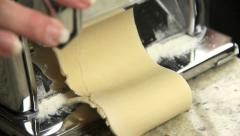 Rolling Dough Through Pasta Maker Stock Footage