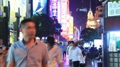Nanjing Road neon crowd time lapse night 3 24 static Stock Footage