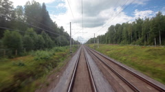 Passenger train traveling through forest railway. View from locomotive window Stock Footage