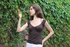 Beautiful Girl Enjoying Nature. Young Woman Contemplate Plant. Stock Photos