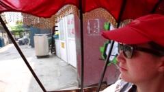 Woman on a rickshaw bike at beijing china Stock Footage