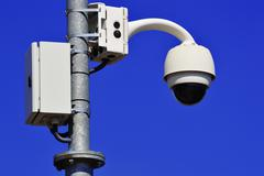 hi-tech dome type camera over  blue sky - stock photo