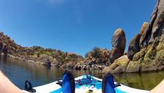 Kayaking Past Multicolored Rocks Canyon Walls- Watson Lake Stock Footage