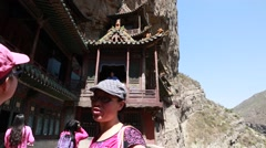 Tourists in hanging temple monastery at datong china Stock Footage