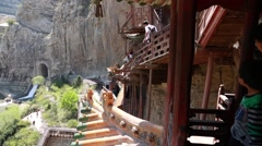 Tourists visiting the hanging temple monastery at datong china Stock Footage