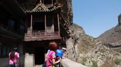 Tourists at hanging temple monastery at datong china Stock Footage