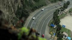 Cars transiting through the green coast Lima Peru Stock Footage