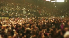 Unrecognizable crowd of people at concert seen on the stands and the floor area Stock Footage