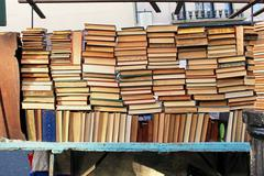 old books pile - stock photo