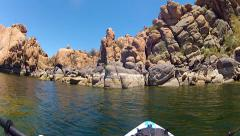 View From Kayak Paddling To Canyon Wall Rock Formations Stock Footage