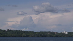 Towering cumulonimbus severe thunderstorm clouds off in the distance with anvil - stock footage