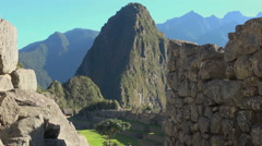 Machu Picchu & Huayna Picchu framed with walls Stock Footage