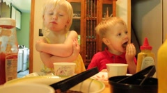 Boy and girl hungrily eat hamburgers Stock Footage