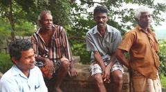 Stock Video Footage of Local workers resting in Sigiriya.