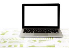 Blank laptop on graphs and charts Stock Photos
