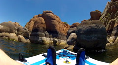 Watson Lake View Of Kayaker Past Rock Formations Canyon Stock Footage