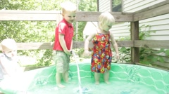 2 year old gets her belly sprayed with hose Stock Footage