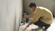 Stock Video Footage of Floor tiles installation. Man installs ceramic tile