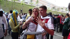 German couple being friendly and give thanks in portuguese in 2014 World Cup Stock Footage