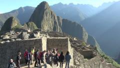 Machu Picchu gate & Huayna Picchu tourist taking photo s Stock Footage