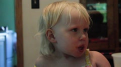 2 year old looks down sadly Stock Footage