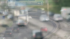 Multi layered traffic shot as people commute to work Stock Footage