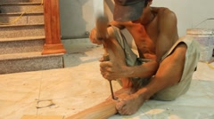 Carpenter processing timber in the house Stock Footage