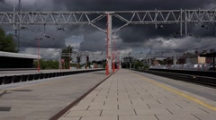 Railway station platform with storm clouds Stock Footage