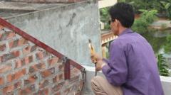 Workers weld steel bar Stock Footage